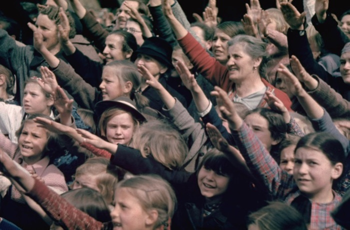 crowds saluting Germans at Schwarzach/St. Veith