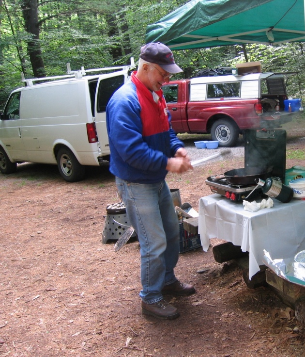 The Camp Commander, cooking.