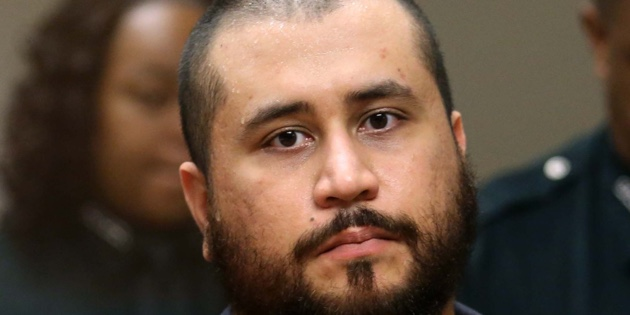George Zimmerman, acquitted in the high-profile killing of unarmed black teenager Trayvon Martin, listens in court Tuesday, Nov. 19,  2013, in Sanford, Fla., during his hearing on charges including aggravated assault stemming from a fight with his girlfriend.  (AP Photo/Orlando Sentinel, Joe Burbank, Pool)